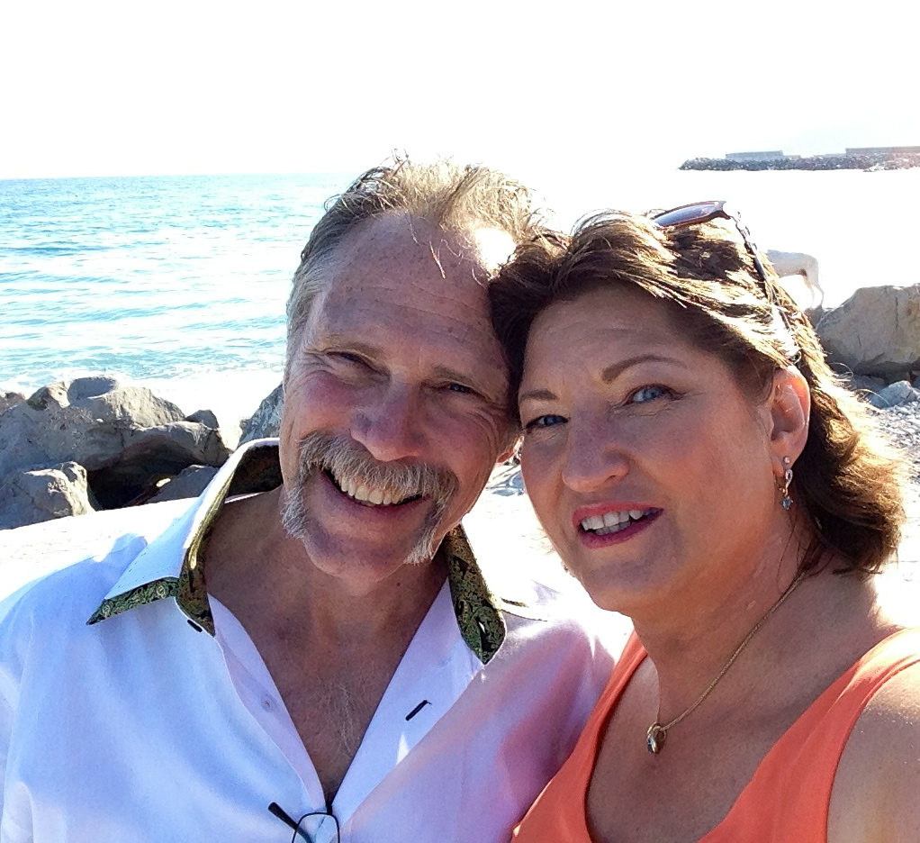 Tom and Nancy on the beach in Italy