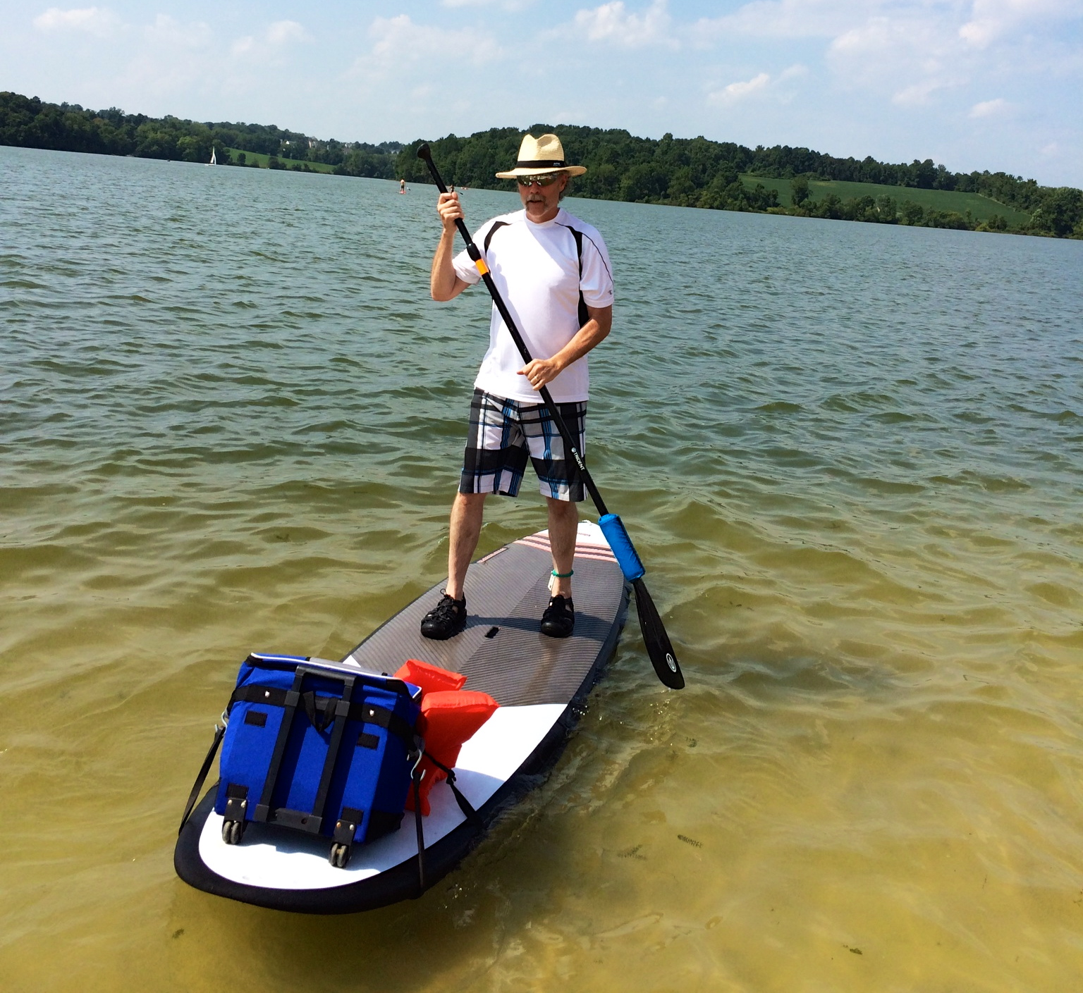 Paddle boarding with refreshment aboard