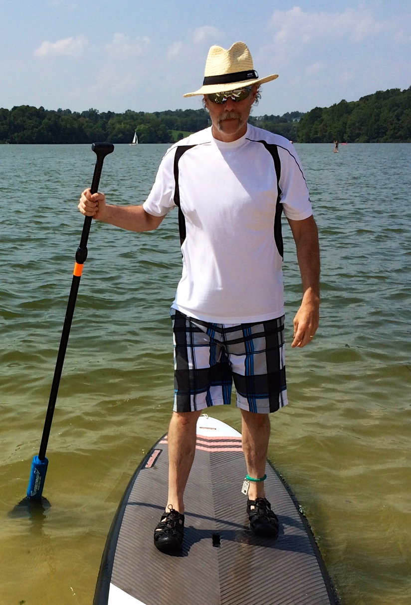 Tom - setting sail on paddle board