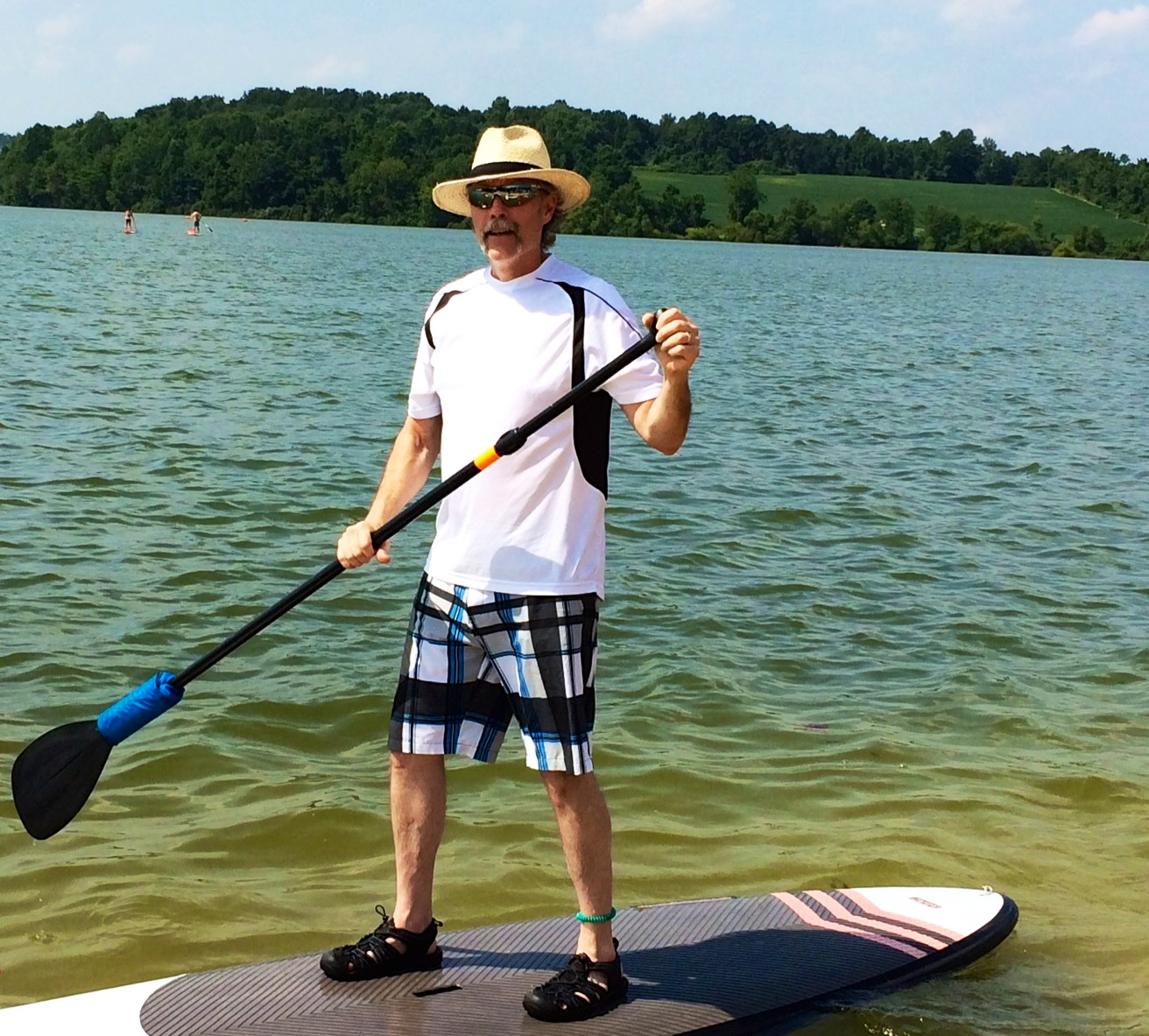 Tom - Working the paddle board out to deeper water